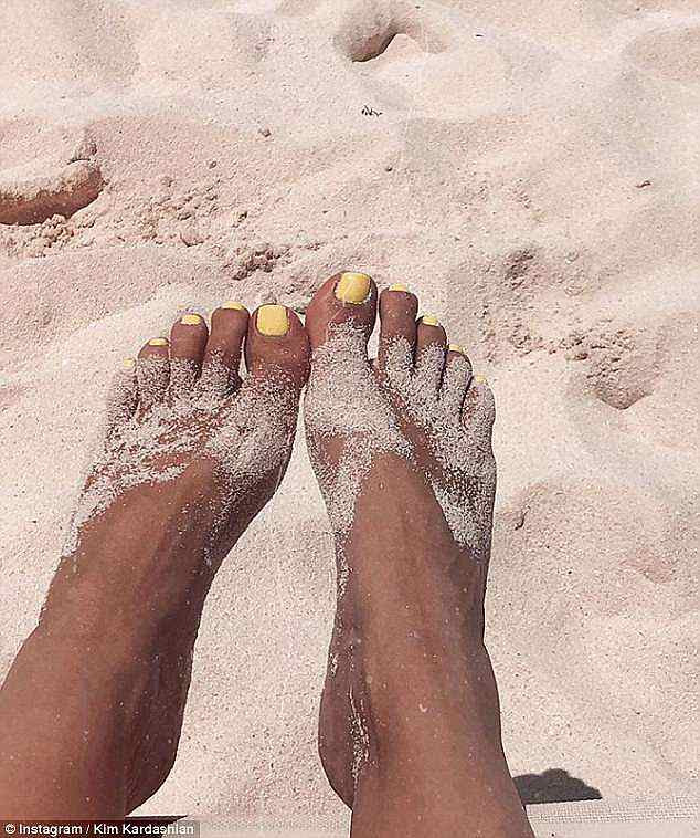 Finding her feet: The wife of Kanye West also shared a close-up snap of her feet in the sand, proving she was having a fantastic time on holiday