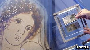 A portrait of Europa is seen next to new and old five-euro notes in Frankfurt, 10 January