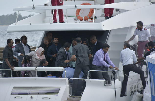 Unidentified injured people are evacuated after a blast on the Maldives President Yameen Abdul Gayoom speedboat in Male, Maldives Monday, Sept. 28, 2015. Gay...