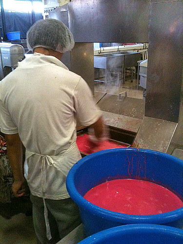 The steamed layered kueh goes around a conveyor belt