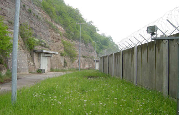 This might look like a prison camp from the outside, but through the doors is the entrance to a secret luxury bunker for millionaires. It is claimed to be the world's largest private shelter and is built from bedrock under a mountain in Rothenstein, Germany. Just wait until you see inside...