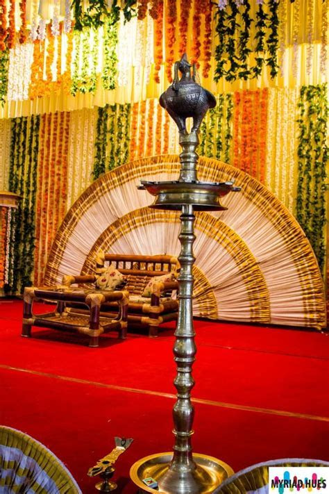 Vibrant Indian stage decor, complete with the peacock lamp