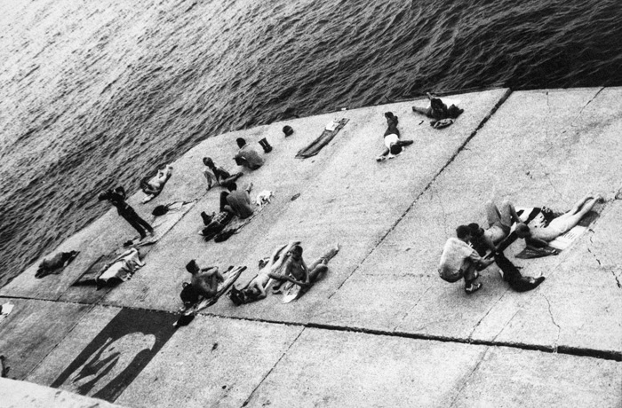 Alvin Baltrop, The Piers (sunbathing platform with Tava mural), 1975–86. COURTESY THIRD STREAMING, NEW YORK AND MOMA PS1