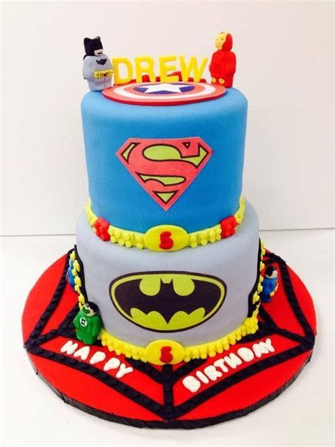 Lego superhero cake featuring Lego Batman, Ironman, Green