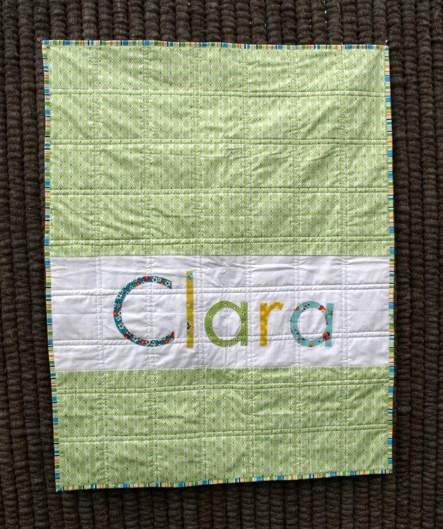 Green baby quilt finished