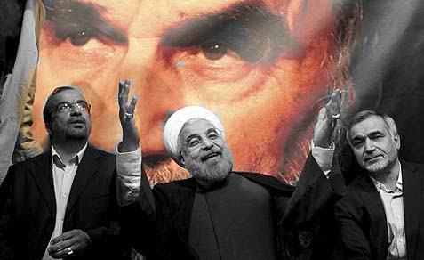 President elect Hasan Rohani (center) under the watchful eyes of the late Ayatollah Khomeini.