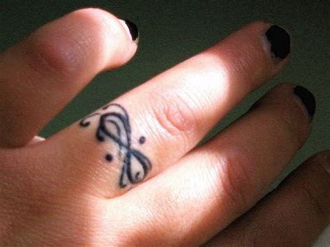 40  Sweet & Meaningful Wedding Ring Tattoos   Stuff to Try