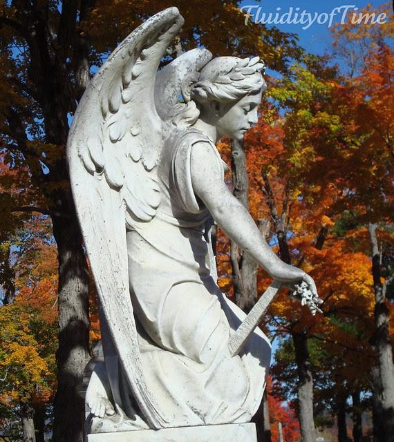 Maine, kneeling angel with sword