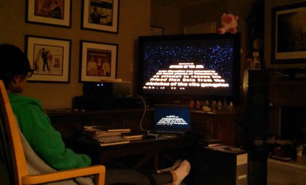 My friend Susie watches the opening crawl for RETURN OF THE JEDI...on December 13, 2015.