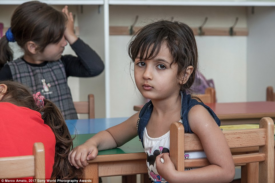 A tired young student poses at a school near Sidone in Lebanon, where around a million Syrian refugees are supported by international organizations