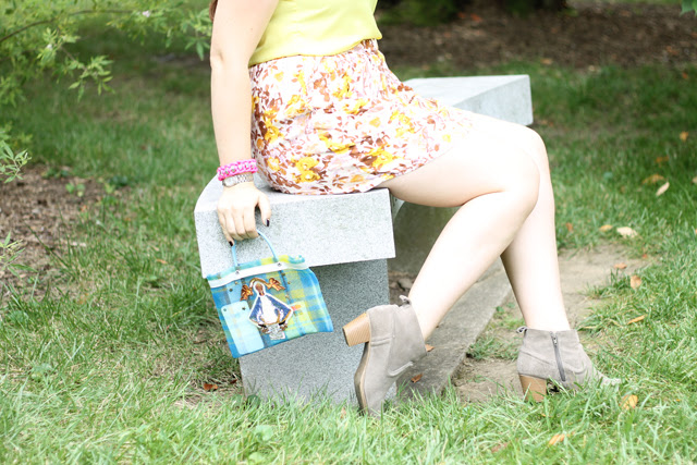 Austin Finds outfit: Yellow blouse, thrifted pink and yellow floral skirt, suede ankle boots, DIY neon chord and metal hardware nut bracelet, kitschy neon plaid plastic bag made from recycled Mexican tote