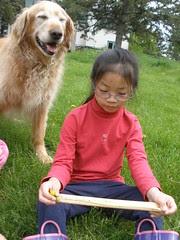 Olivia Measuring a Dandelion