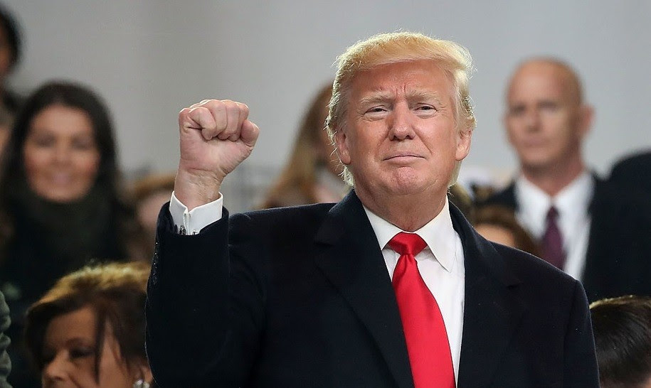 President Donald Trump waves to the crowd from the inaugural parade revieing stand in front of the White House on January 20, 2017 in Washington, DC. Donald Trump was sworn in as the nation's 45th president today. (Photo by Mark Wilson/Getty Images)