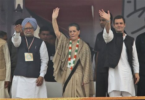 From left, Indian Prime Minister Manmohan Singh, Congress party president Sonia Gandhi and Congress party general secretary Rahul Gandhi wave to party supporters during a public rally, in New Delhi, India , Sunday, Nov. 4, 2012.