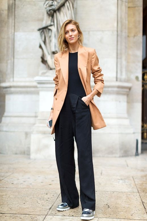 Le Fashion Blog Street Style Pfw Model Off Duty Anja Rubik Long Camel Blazer Wide Leg Black Pants Silver Metallic Oxfords Via Harpers Bazaar