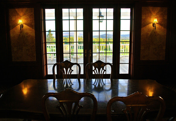 The dining room table in the Dodge Parlor