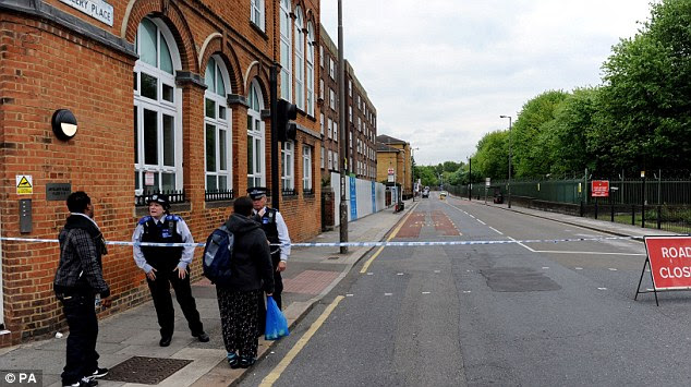 Probe: Police cordon off surrounding roads after a man was killed in Woolwich, south London
