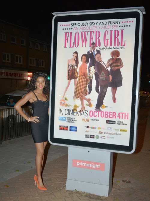 Lead Actress Damilola posturing beside a Flower Girl Billboard in London