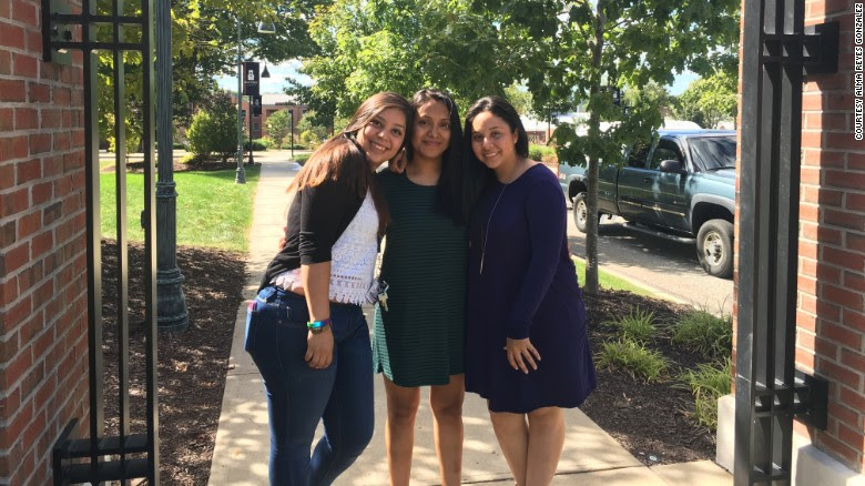 DACA recipient Alma Reyes Gonzalez, center, is double-majoring in biology and philosophy at the Eastern Connecticut State University.