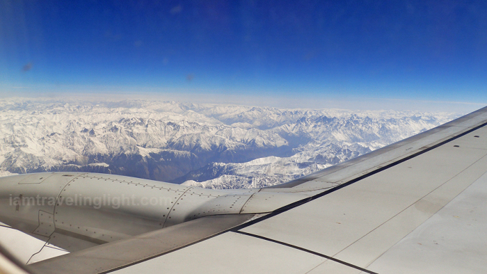 himalayas-mountain-range-medium-shot-tail-end-winter-view-from-the-plane-with-aircraft-wings-flight-to-leh-from-new-delhi-india.jpg