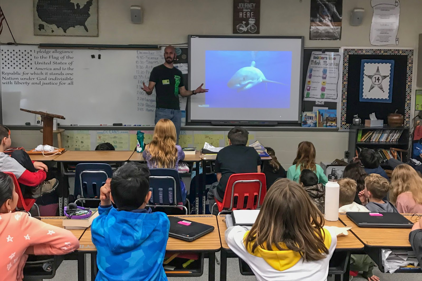 Photographer George Probst shares stories about sharks in a classroom.