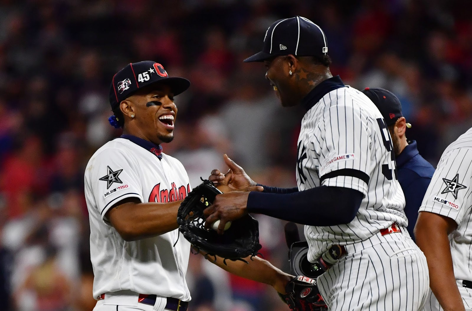 Aroldis Chapman of the Yankees shakes hands with Francisco Lindor of the Indians after the American League won the All-Star Game.
