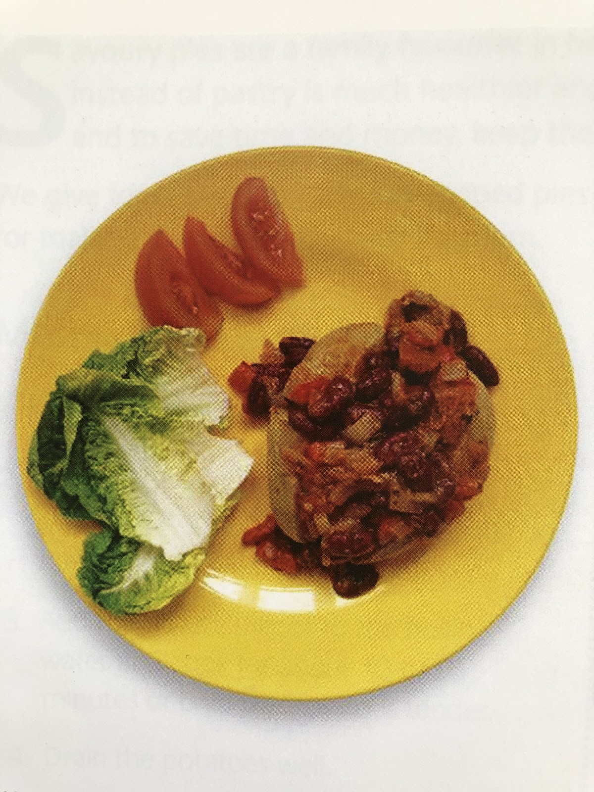 Jack potato and vegetable chile served with tomato lettuce