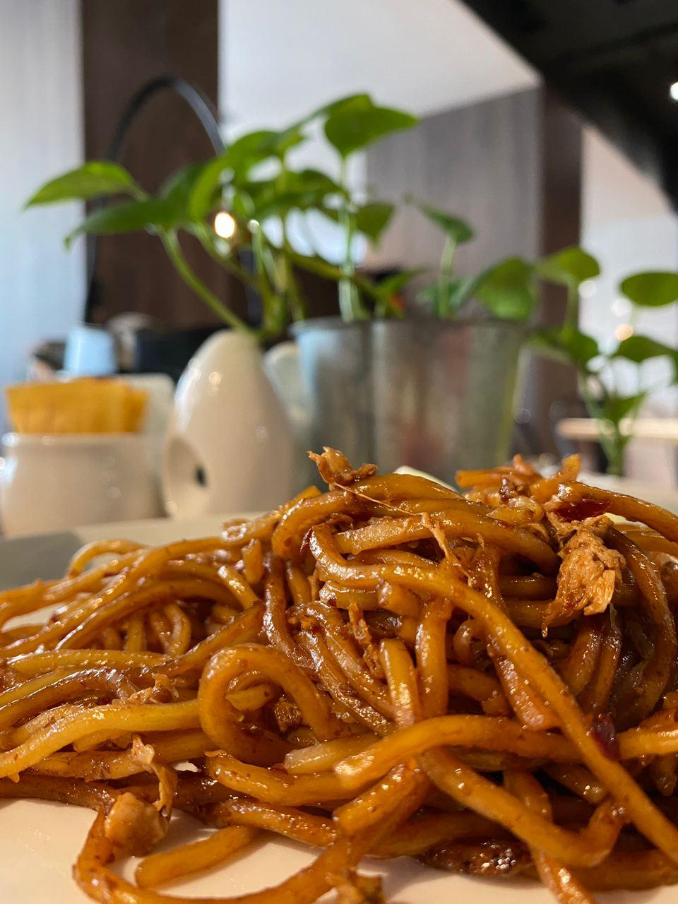 A picture containing food, chow mein, indoor, friesDescription automatically generated