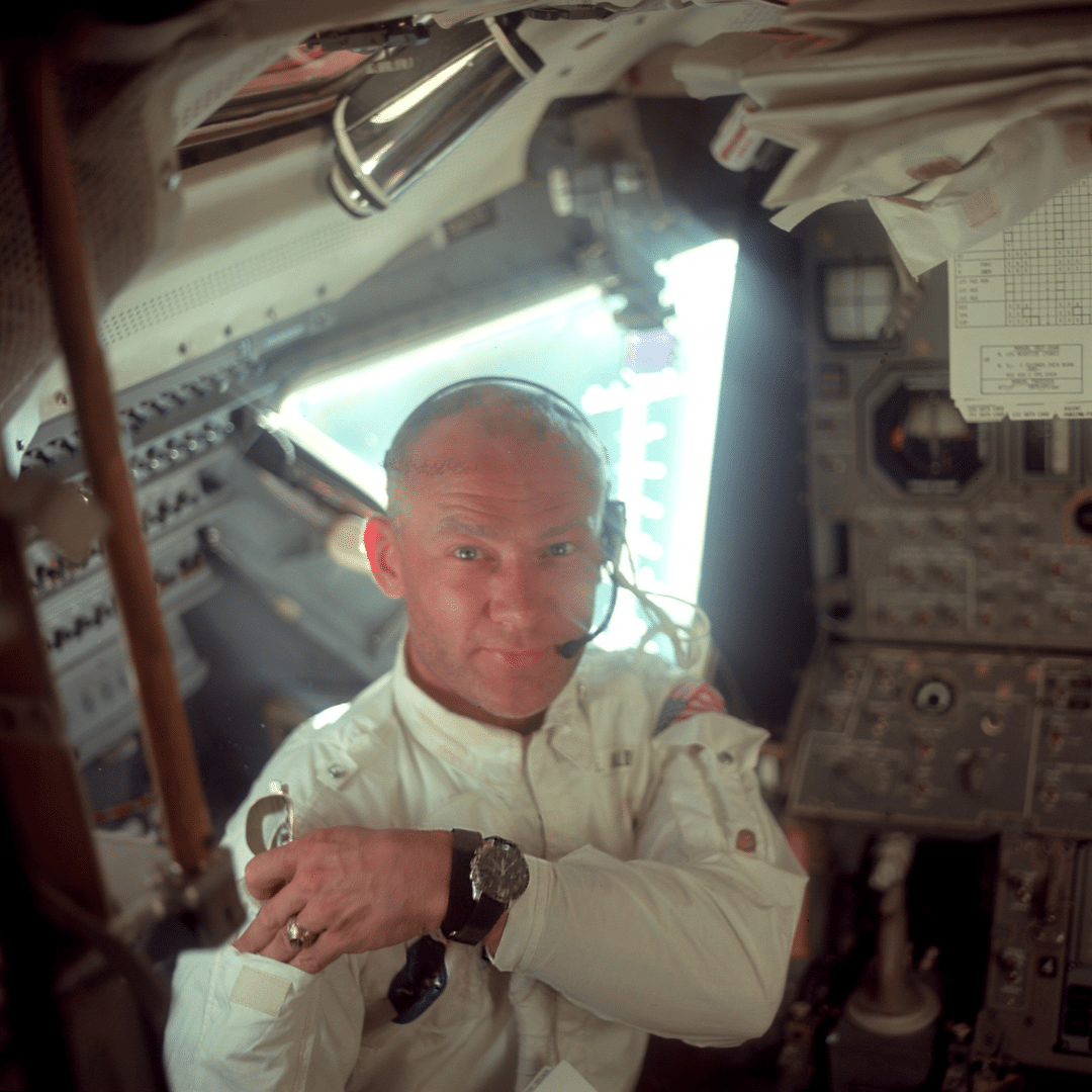 Photo of Buzz Aldrin wearing an Omega Speedmaster on the Apollo 11 mission. He is inside the space rocket.