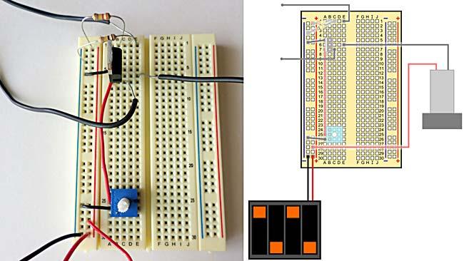 A breadboard with wires, resistors, transistor, resistors, and connections to a battery pack and pump.