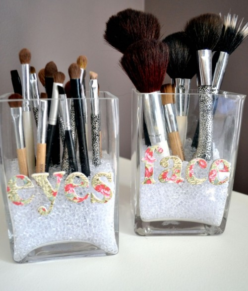 Simple vases are an inexpensive yet classy way to store makeup brushes!