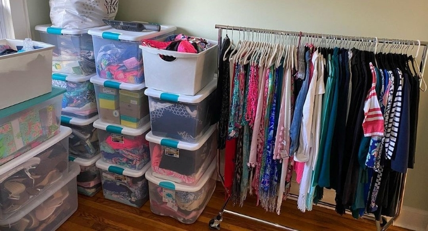 Clothing and other items packed inside sturdy plastic bins.