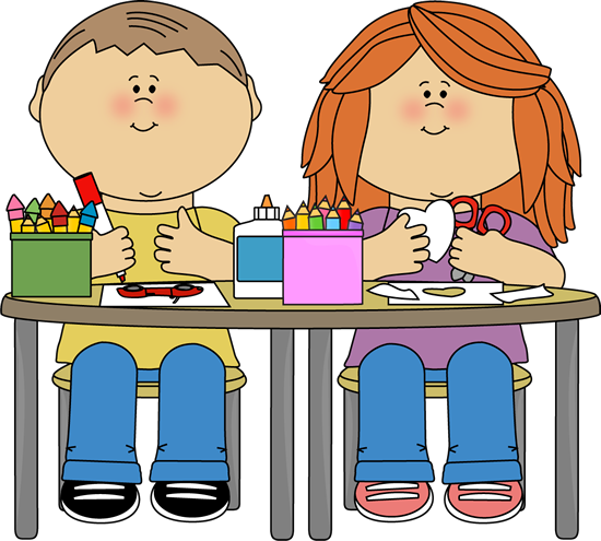 Children sitting at table with crayons