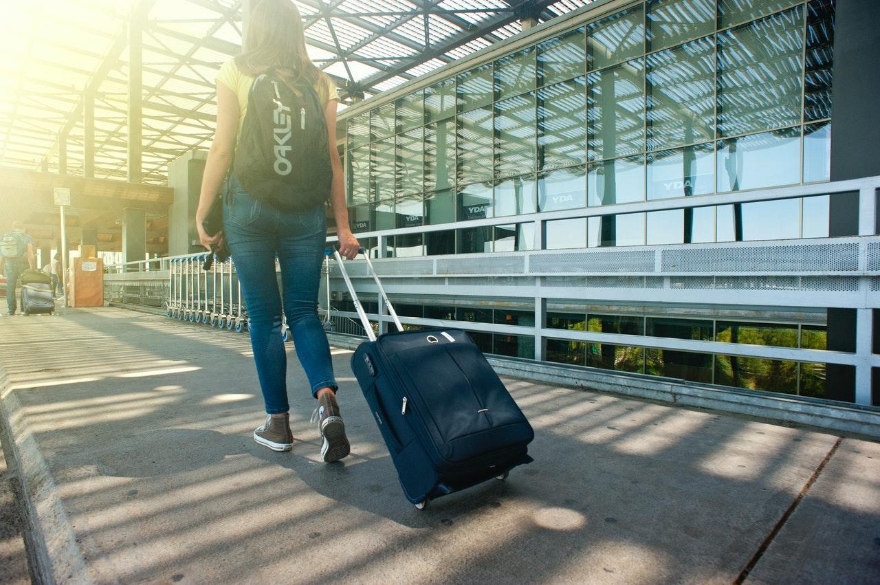 C:UsersWasifAppDataLocalMicrosoftWindowsINetCacheContent.Wordwoman-walking-on-pathway-while-strolling-luggage-1008155.jpg