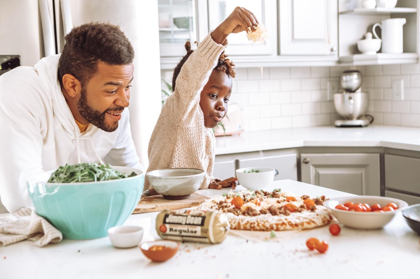 Two people preparing food  Description automatically generated with low confidence