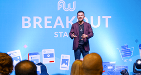 ecommerce millionaire mastery kevin zhang presenting at a conference