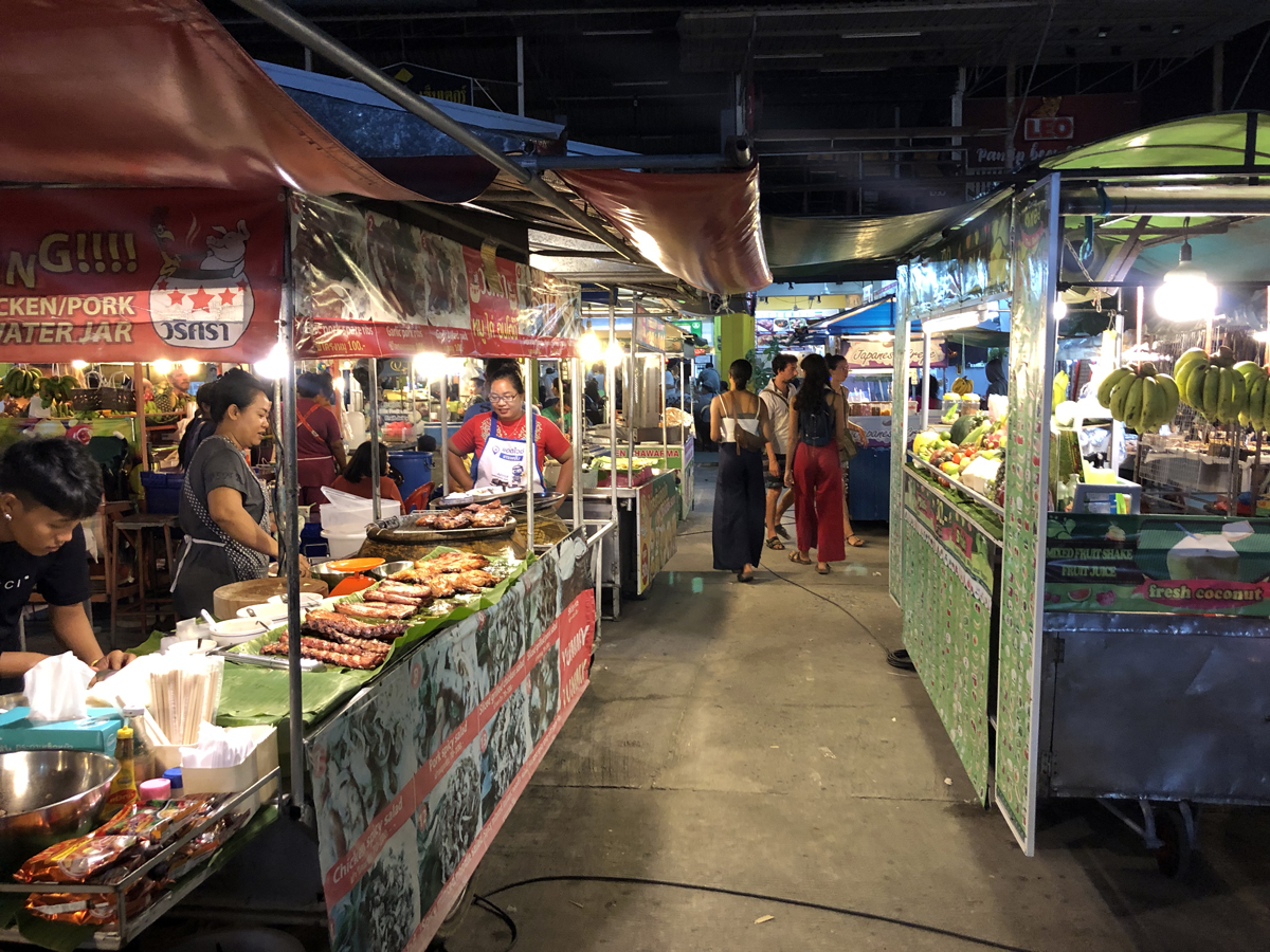 Thai street food market, food stalls and vendors