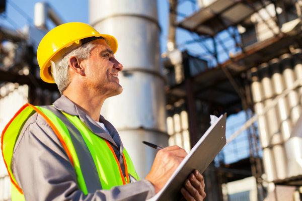 An engineer using a generator maintenance checklist