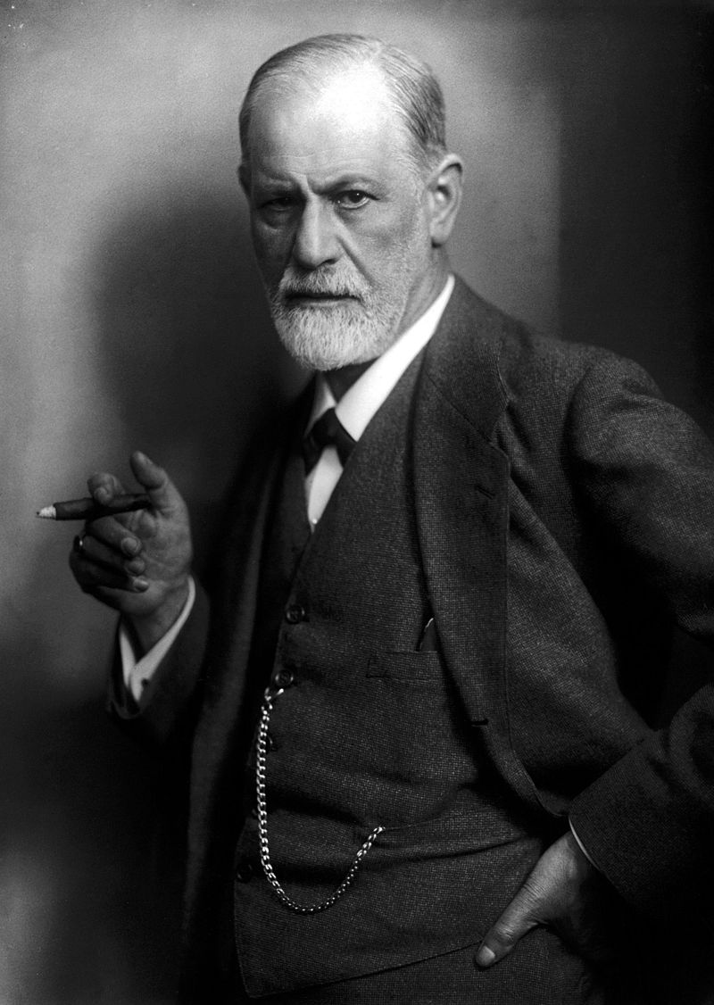 Sigmund Freud in a suit, holding a cigar.
