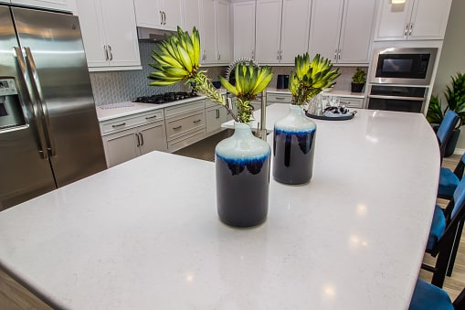 Benefits of Quartz Countertops; white countertop with two decorative vases placed on it