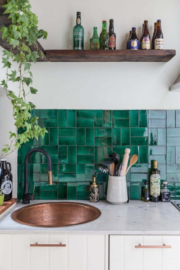 eclectic kitchen with emerald green tile backsplash