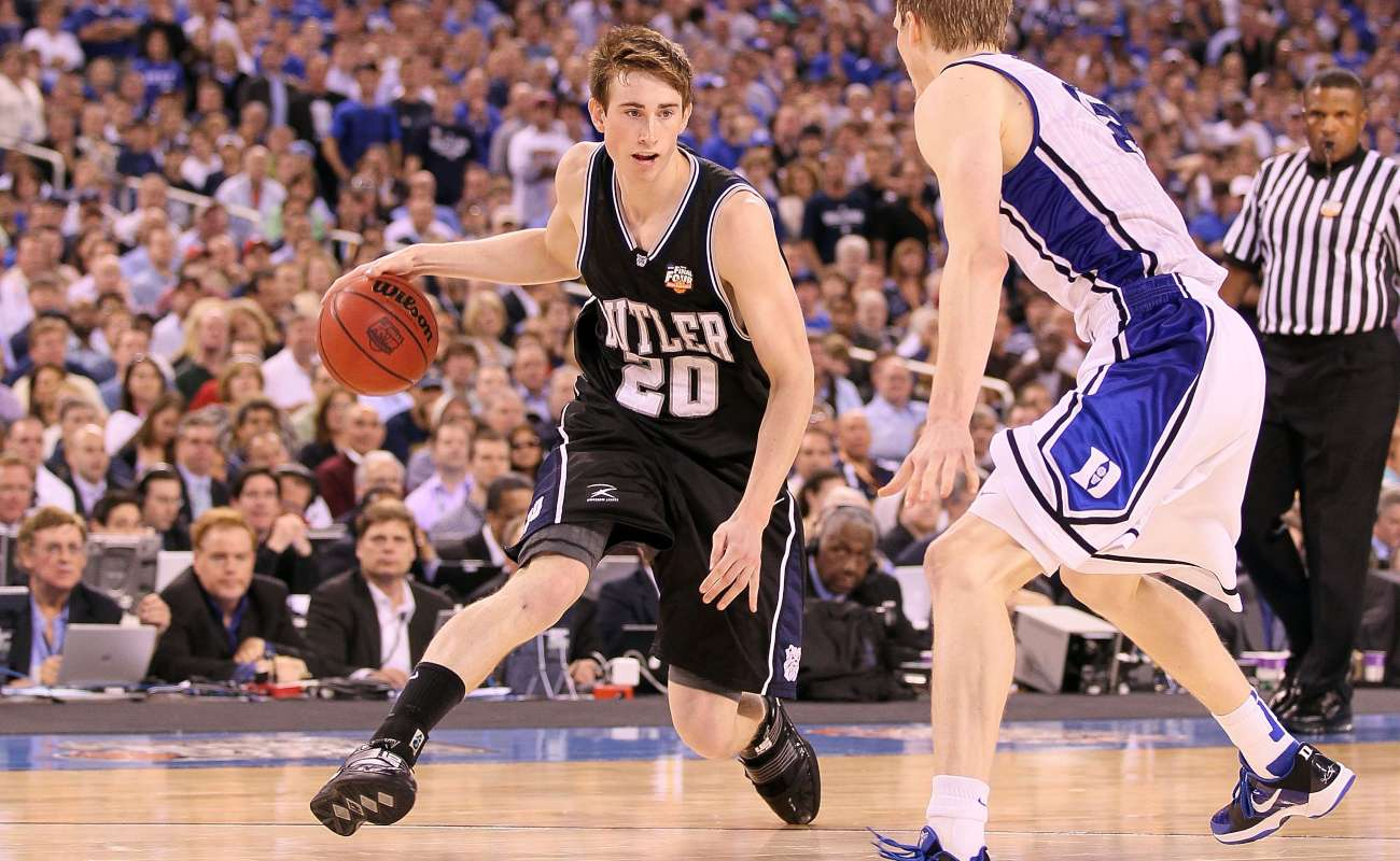 Gordon Hayward #20 of the Butler Bulldogs drives against Kyle Singler #12 of the Duke Blue Devils during the 2010 NCAA Division I Men's Basketball National Championship game at Lucas Oil Stadium on April 5, 2010 in Indianapolis, Indiana. Duke won 61-59. (Photo by Andy Lyons/Getty Images)