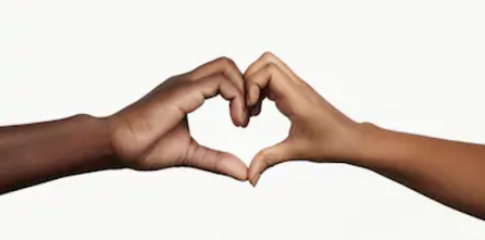 [Image: two hands reach to touch one another, with fingers curled to create a heart shape. The hand on the left is dark skinned; the hand on the right is medium skin tone.]