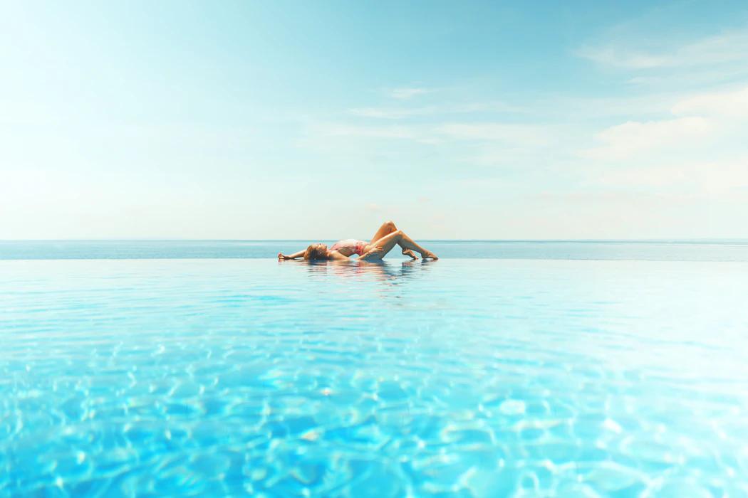 woman posing on pool edge