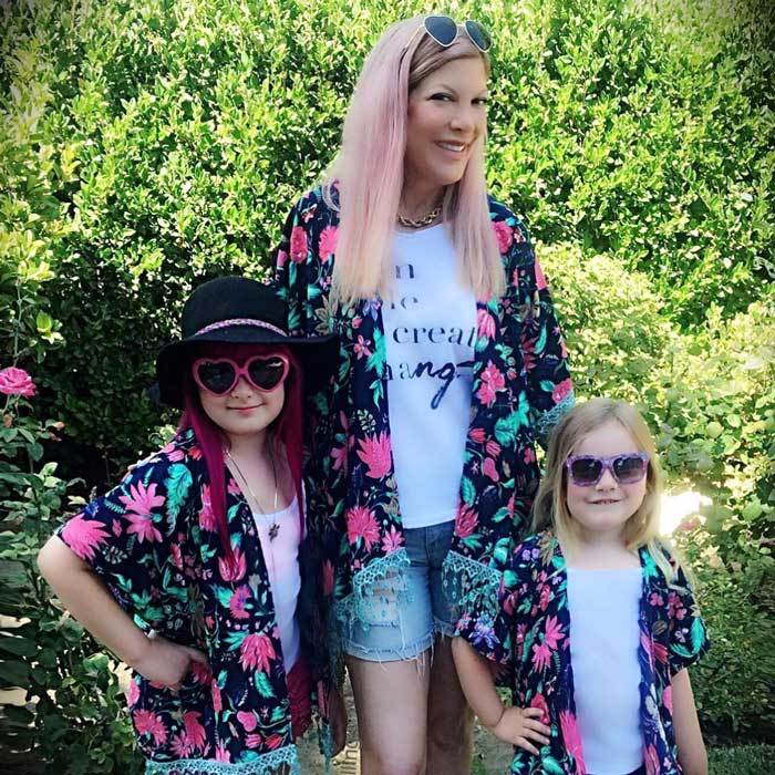 "<b><a href=""https://us.hellomagazine.com/tags/1/tori-spelling/""><strong>Tori Spelling</strong></a>, Stella and Hattie McDermott</b><br>Flower power! The actress and her daughters channeled their inner hippies wearing vibrant print kimonos from Haberdash Soul Company, paired with groovy shades and shorts.</br><br>Photo: Instagram/@torispelling"