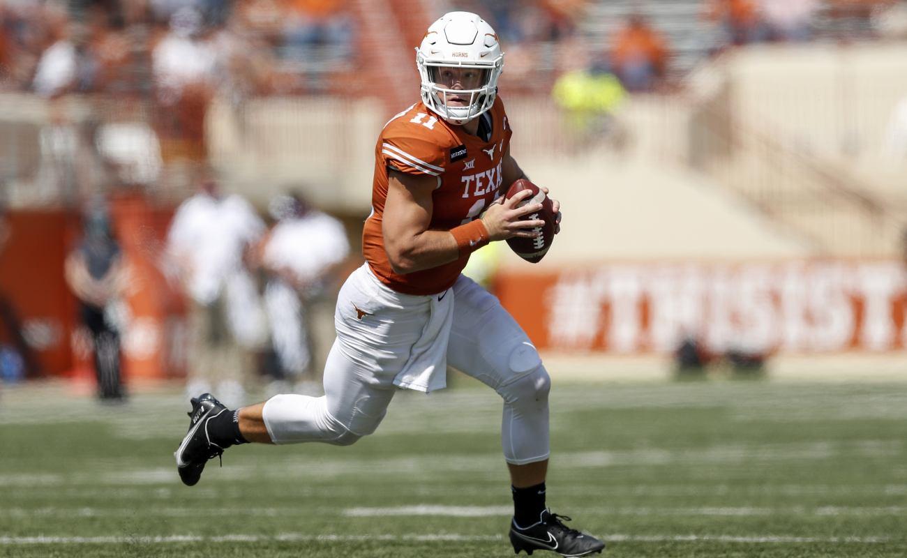 Texas Longhorns' Sam Ehlinger looks for a pass.