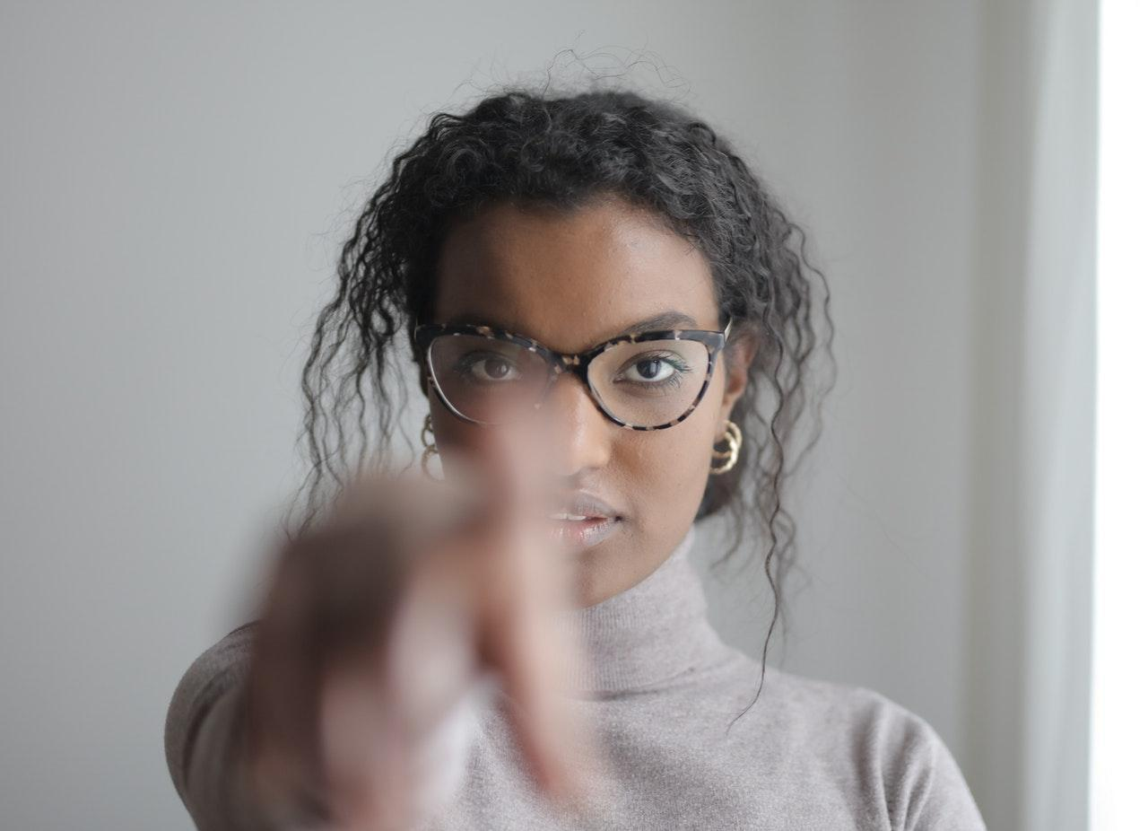 A woman pointing at you