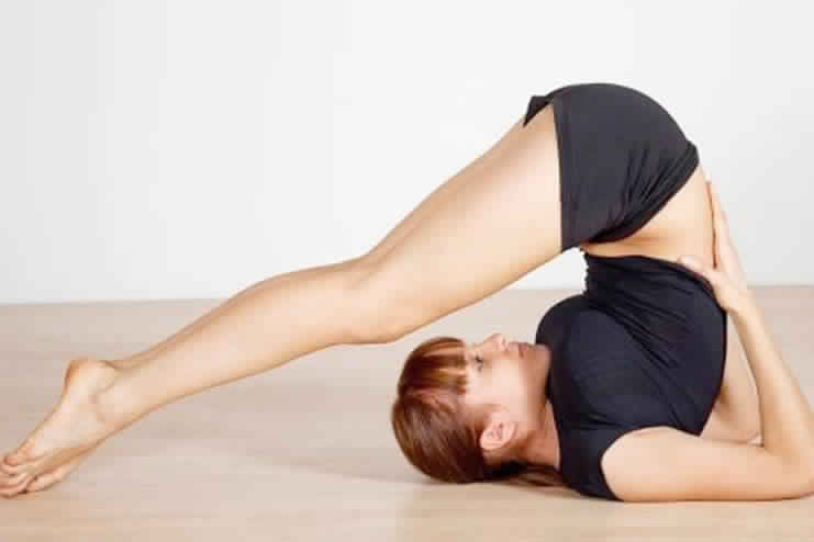 halasana or plow pose for glowing skin