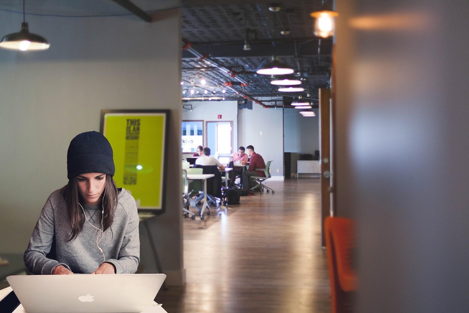 female worker sitting in quiet corner of her best coworking spaces