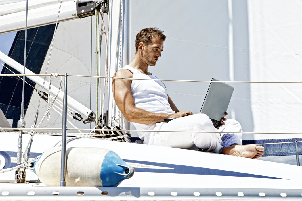 man working on a yacht